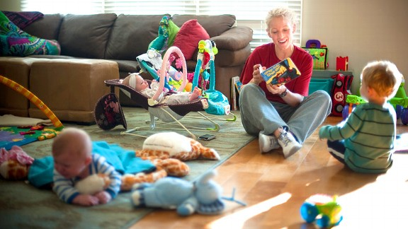 Five-month-old twins Avery, left, and Flory, and 20-month-old Finley, right, keep Borchardt busy at home.