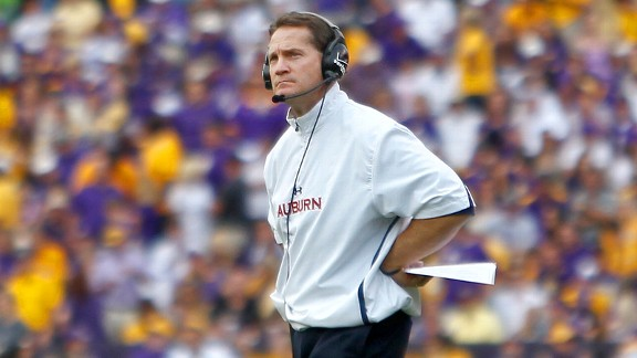 Why the long face? Former Auburn coach Gene Chizik has 208,334 reasons to smile each and every month.