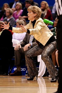 Kim Mulkey swears she'd prefer sweatpants, but snakeskin pants are the next best thing.
