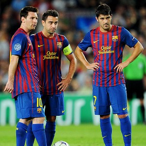 Lionel Messi (L), Xavi Hernandez (C) and David Villa