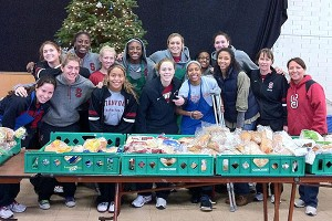 The players served meals, sorted toys and sang carols at St. Anthony of Padua Church in nearby Menlo Park, which has become part an annual part of the holiday season for the Cardinal.