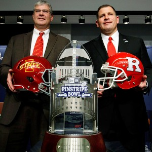 Paul Rhoads, Greg Schiano and Pinstripe Bowl trophy
