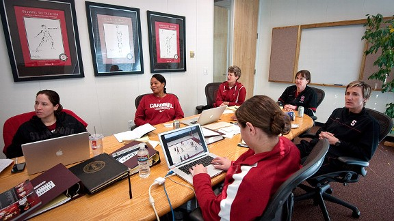 From left, Stanford intern Liz Rizza, assistants Trina Patterson and Amy Tucker, coach Tara VanDerveer, assistant Kate Paye and video coordinator Lauren Greif review practice footage during a coaches' meeting.