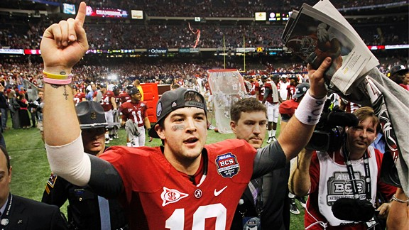 Alabama's AJ McCarron celebrates after leading his team to a BCS National Championship against LSU Monday, Jan. 9, 2012, in New Orleans. Alabama won 21-0.