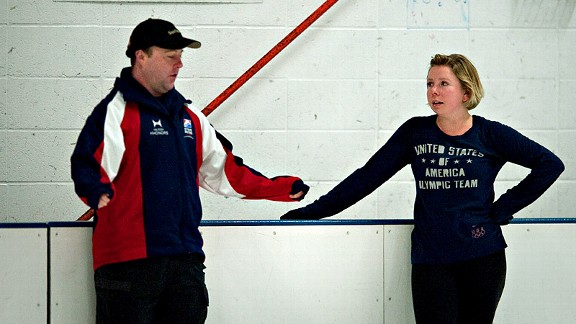 Rachael Flatt consults with her coach, Justin Dillon, during a recent practice at the Oakland Ice Center.