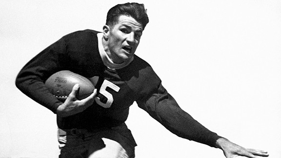 Sammy Baugh, backfield star of Texas Christian University, is demonstrating his sidestepping ability in Dallas, Dec. 15, 1936. TCU will face Marquette in the Cotton Bowl game on New Year's Day.