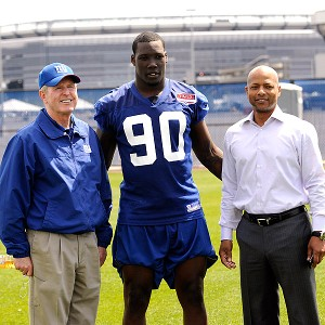 Tom Coughlin, Jason Pierre-Paul and Jerry Reese