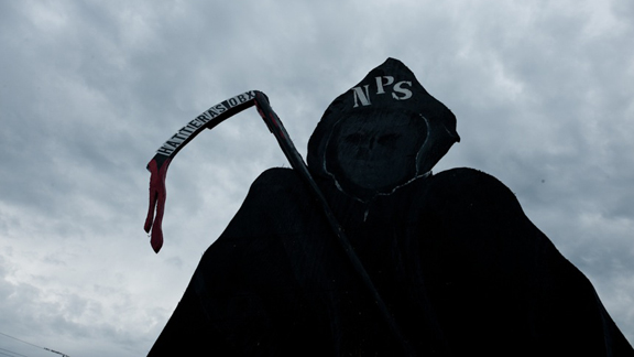 Outer Banks locals see the National Parks Service rules as being the death of their liberties and economy, depicted here by the NPS Grim Reaper off NC Highway 12.