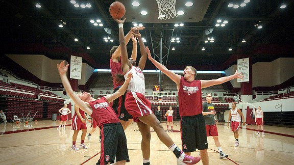 Paul Ocklemann, Andrew Klein and Austin Link triple-team Chiney Ogwumike during practice.