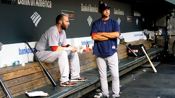 Terry Francona and Dustin Pedroia after losing to the Orioles in 2011