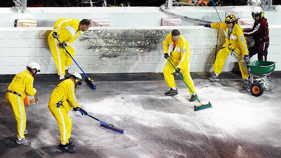 Safety workers clean up the track