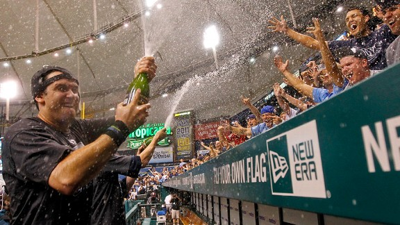 Evan Longoria celebrates with Tampa Bay Rays fans in 2011