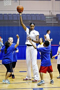 Lisa Leslie keeps kids moving with basketball drills at the mini-Olympic competition.