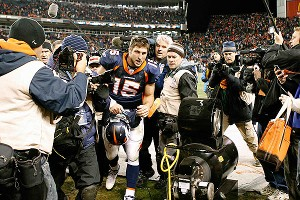 Tim Tebow with the Denver Broncos after beating the Pittsburgh Steelers in the 2011 AFC wild card game
