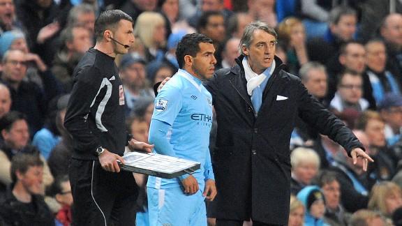 Roberto Mancini and Carlos Tevez and