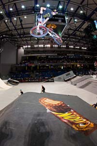 DC Shoes rider Brett Banasiewicz spins a 360 downside tailwhip over the box jump.