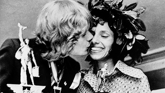 Nina Kuscsik, winner of the 1972 Boston Marathon -- the first to officially allow women -- gets a kiss from Olavi Suomalainen, the top male finisher.