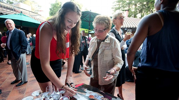 Bonnie Samuelson signs an autograph for a supporter during Stanford's postseason banquet at the Faculty Club.