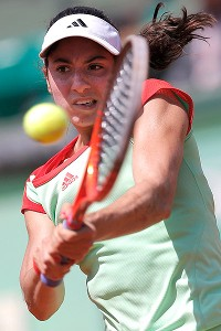 American Christina McHale battled valiantly in the Bull Ring, but was upset in three sets by Li Na.