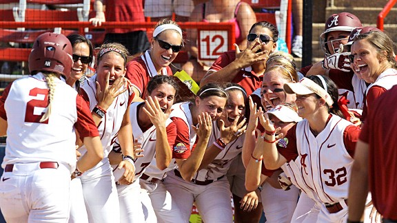 Alabama senior Jazlyn Lunceford (2) is greeted by teammates after her home run against California.