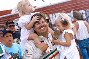 Courtney Force, on the shoulders of John, has been spending time at the racetrack since she was in diapers.