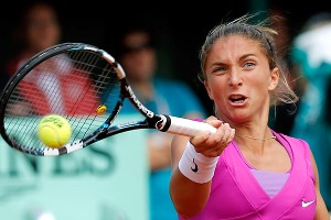 Sara Errani battled in her first Grand Slam final, but with tired legs she couldn't overcome a determined Maria Sharapova.