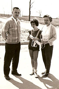 Maureen Wilton Mancuso stands with her parents following her record-setting marathon.