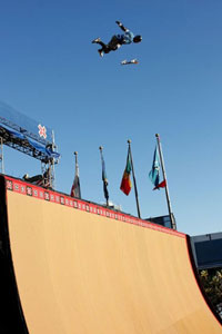 Twenty-time X Games medalist Bob Burnquist braces for impact in Skateboard Big Air practice Tuesday.