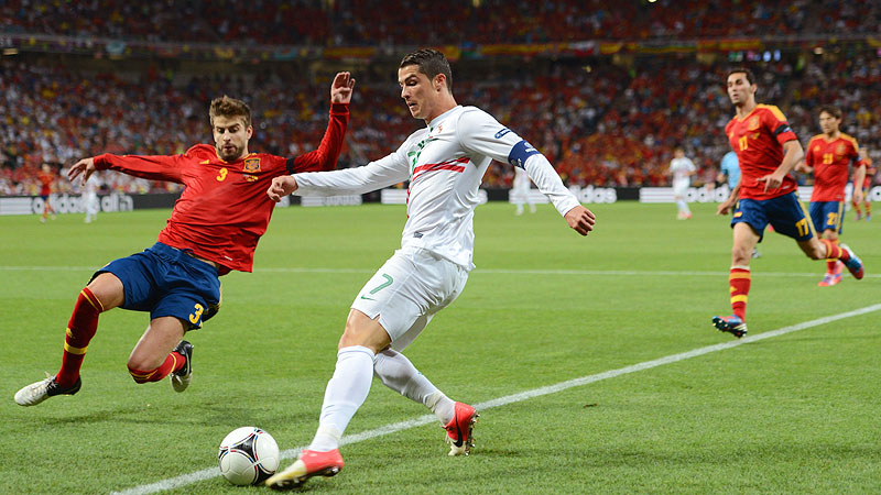 Gerard Pique of Spain defends from Cristiano Ronaldo of Portugal during the Euro 2012 semifinals in Donetsk.