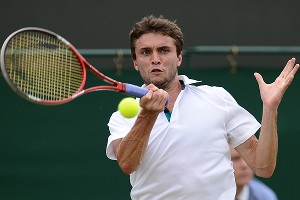 Gilles Simon says men's tennis is more entertaining than women's. He says he thinks men should earn more at majors.