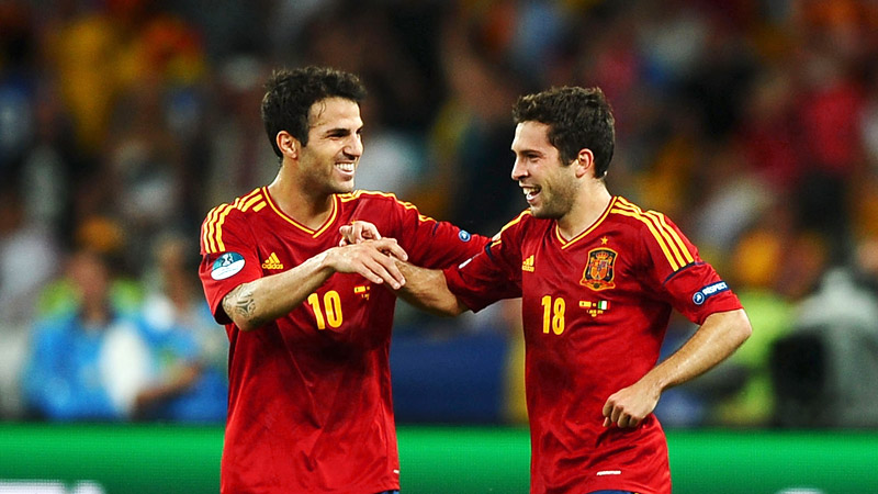 Jordi Alba and Cesc Fabregas celebrate during Spain's match against Italy in the Euro 2012 final.