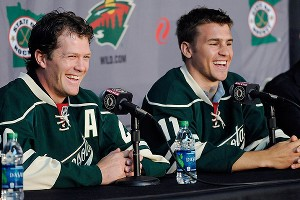 Ryan Suter (left) and Zach Parise signed matching 13-year, $98 million contracts with the Wild.