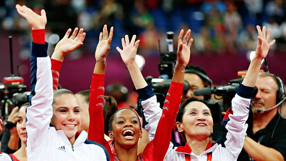 Gabrielle Douglas, center, and the U.S. women's team won their first team gold in gymnastics since 1996.