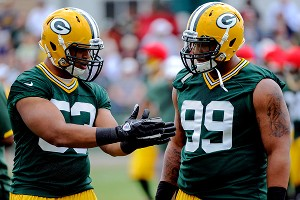 Green Bay's Nick Perry and Jerel Worthy
