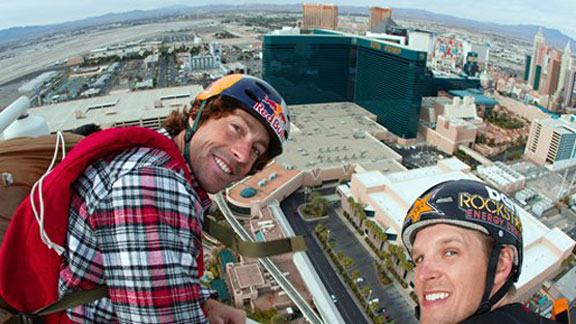 Travis Pastrana is seen with Erik Roner preparing to base jump off The Signature at the MGM Grand Hotel & Casino on Wed. June 1, 2011 to promote the premiere of Nitro Circus Live.