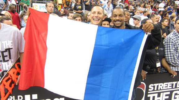 Chris Nieratko flies the French flag in support of Street League competitor Bastien Salabanzi.