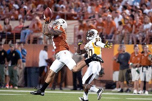 Kenny Vaccaro's interception in the first half against Wyoming helped Texas surge ahead.