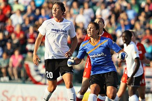 Wambach (left) and Hope Solo, two of Borislow's stars, have been firm in their support of the MagicJack owner.