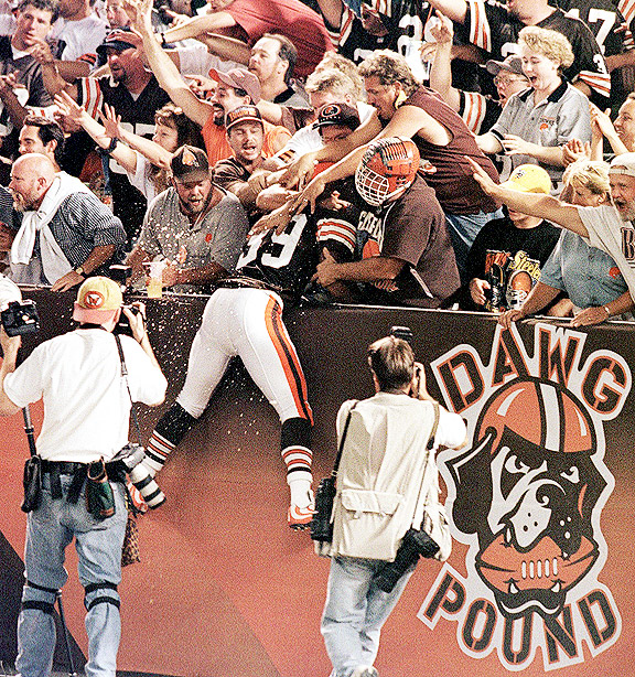 Marlon Forbes leaps into the arms of Cleveland Browns fans.