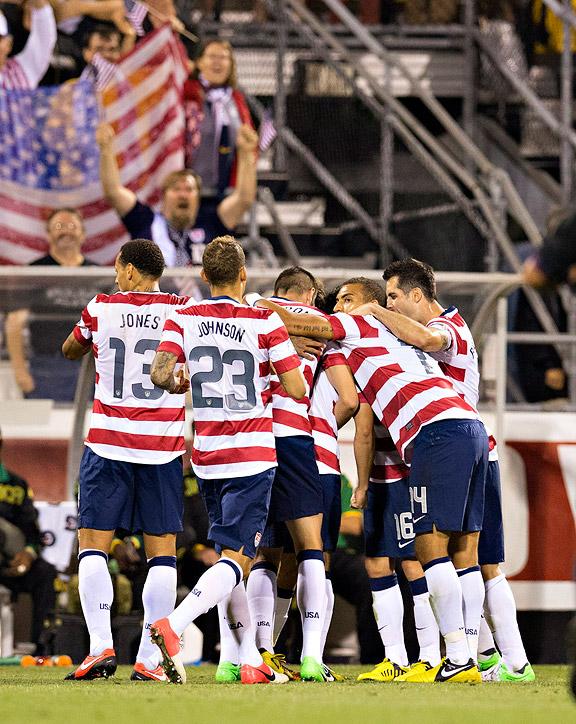 Team USA celebrates Herculez Gomez's goal