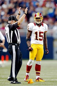 Josh MorganST LOUIS, MO - SEPTEMBER 16:  Wide receiver Josh Morgan #15 of the Washington Redskins is penalized after committing a personal foul in the last minute of the game resulting in a fourth and long scenario against the St. Louis Rams at Edward Jon