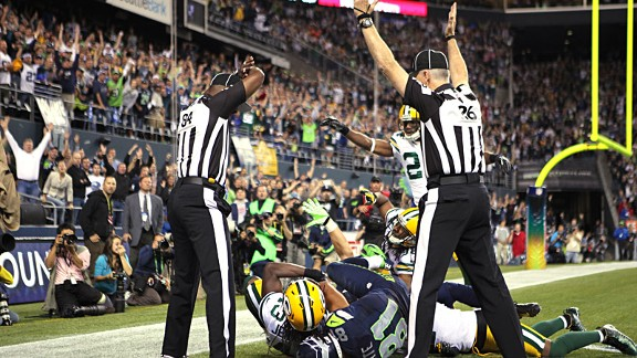 Golden Tate of the Seattle Seahawks and M.D. Jennings of the Green Bay Packers with the NFL replacement referees