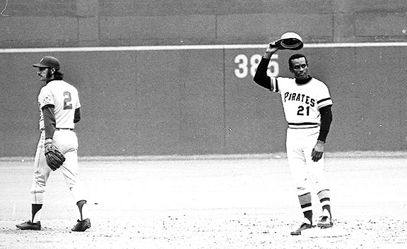 Roberto Clemente celebrating his 3,000th hit
