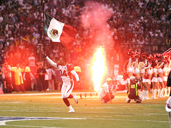 Arizona Cardinals' Robert Griffith carrying the Mexican flag in Mexico City