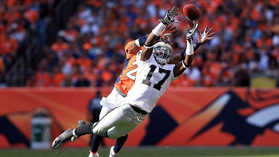 Denarius Moore tries to catch a pass against the Denver Broncos