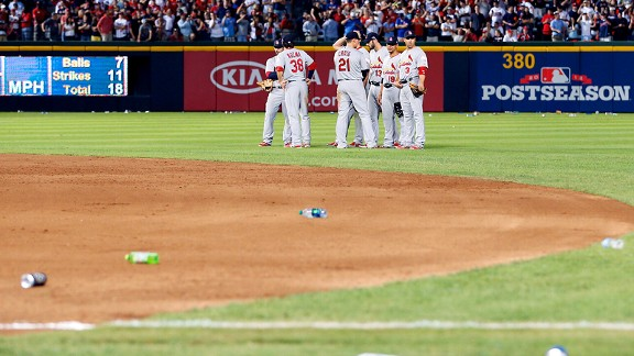 Bottles and cups on the field during St. Louis Cardinals-Atlanta Braves