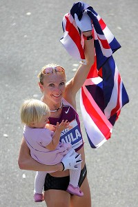 Radcliffe celebrates her 2008 New York Marathon win with daughter Isla.