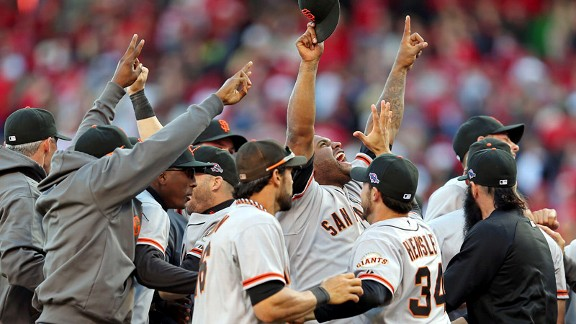 Pablo Sandoval and the Giants celebrating their win over the Cincinnati Reds
