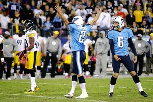 AP Photo/Wade Payne Rob Bironas (2) celebrates his winning kick