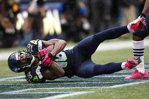AP Photo/John Froschauer Seattle receiver Sidney Rice's touchdown